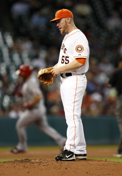 Houston Astros Brett Olberholtzer, right, reacts as Los Angeles Angels Chris Iannetta rounds third base after hitting a solo home run in the third inning of a baseball game Saturday, Sept. 14, 2013 at Minute Maid Park in Houston. (AP Photo/Eric Christian Smith)