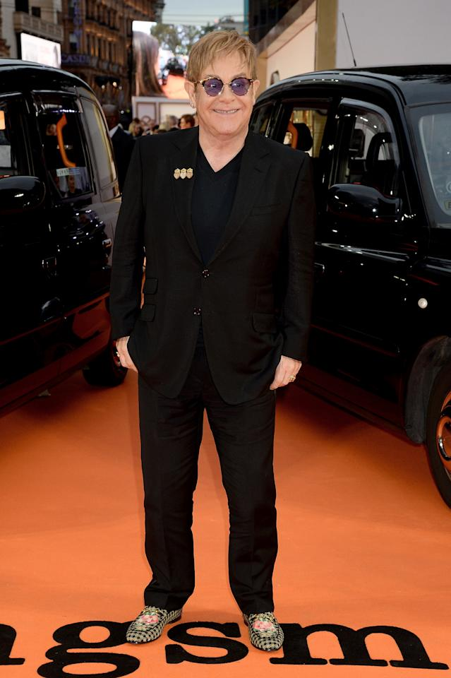 "<p>Singer Elton John maintained a youthful glow at the ""Kingsman: The Golden Circle'""World Premiere in floral pattered loafers and a jet black suit. <i>(Image via Getty)</i> </p>"