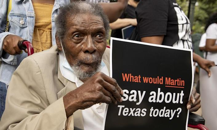 Bobby Caldwell, 87, of Houston, listens during a prayer rally against Republican bills that would make it harder to vote at the capitol in Austin, Texas, last week.