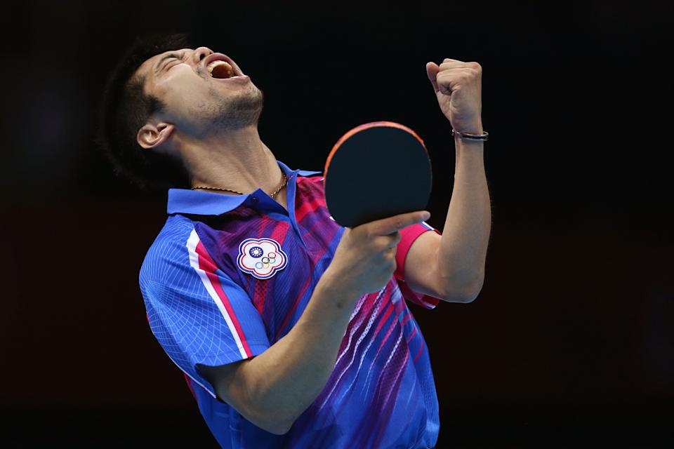 LONDON, ENGLAND - AUGUST 02:  Chih-Yuan Chuang of Chinese Taipei celebrates a point during Men's Singles Table Tennis Bronze medal match against Dimitrij Ovtcharov of Germany on Day 6 of the London 2012 Olympic Games at ExCeL on August 2, 2012 in London, England.  (Photo by Feng Li/Getty Images)