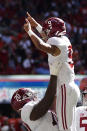 Alabama quarterback Bryce Young (9). celebrates with offensive lineman Javion Cohen (70) after a touchdown in the first half of an NCAA college football game against Miami, Saturday, Sept. 4, 2021, in Atlanta. (AP Photo/John Bazemore)