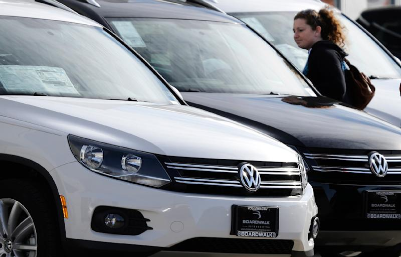 In this Feb. 22, 2013 photo, Meredith Havens, who recently moved to Texas from Alaska, looks at Volkswagens at a dealership in Richardson, Texas. Industry analysts expect February's sales to be up about 7 percent from a year earlier as pent-up demand and cheap financing kept the U.S. auto sales recovery powering along. Volkswagen reported its best February since 1973. (AP Photo/LM Otero)