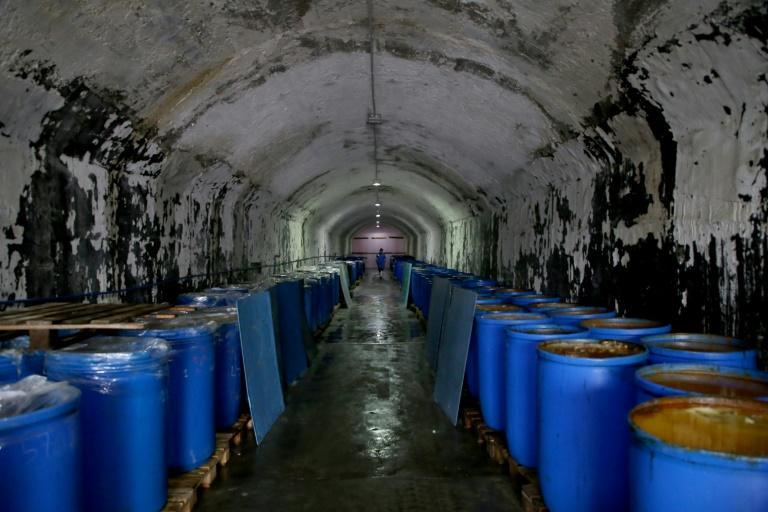 In darkened tunnels once stuffed with weapons, there are now hundreds of blue barrels filled with anchovies resting in litres of brine