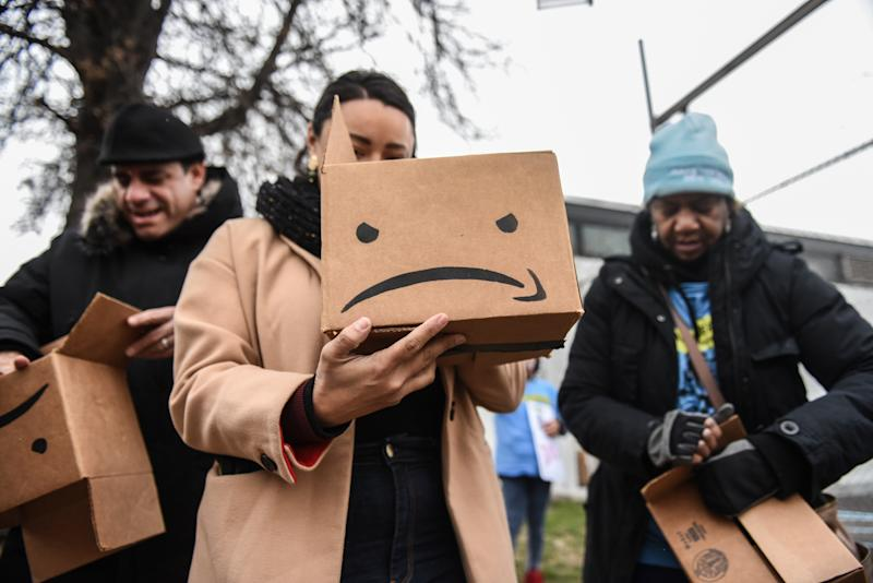 NEW YORK, NY - DECEMBER 16: Immigrant and labor activists participate in a rally outside of a Amazon distribution center on December 16, 2019 in the Queens borough of New York City. Activists voiced concerns about the safety in the Amazon warehouse work environment. A Reveal investigation from the Center for Investigative Reporting found the rate of serious injuries for 23 facilities studied was more than double the national average for the warehousing industry. (Photo by Stephanie Keith/Getty Images)
