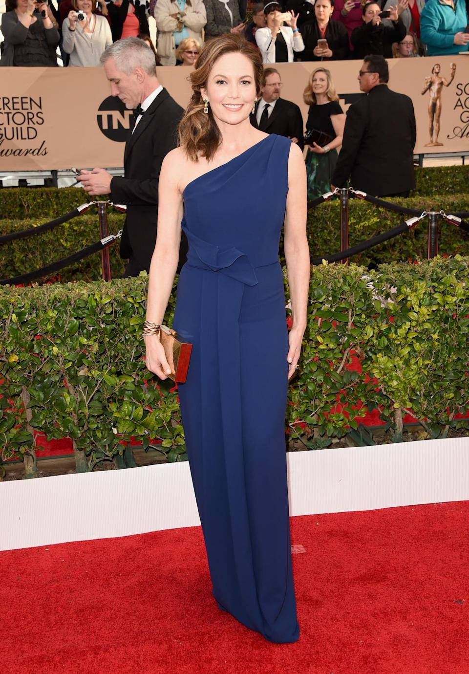 <p>Diane Lane's red carpet look was blue — but she looked anything but! And her gold clutch only added to the elegance of the ensemble. <i>Photo: Getty Images</i></p>