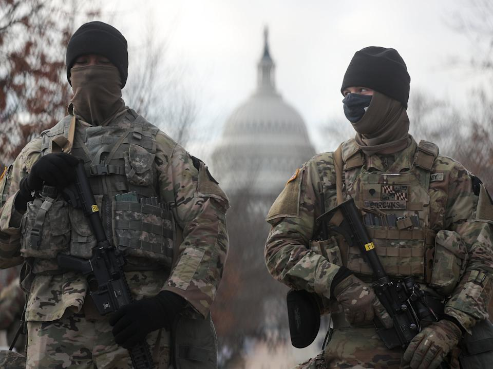 US National Guardsmen stand on a closed street outside the Capitol Building. Some 25,000 National Guard troops have been brought in from across the country to ensure security on Inauguration Day, replacing the huge crowds of tourists that would usually gather in the nation's capital to welcome a new presidentYegor Aleyev/TASS