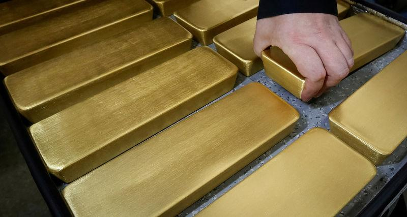 An employee stores newly cast ingots of 99.99 percent pure gold at the Krastsvetmet non-ferrous metals plant in the Siberian city of Krasnoyarsk
