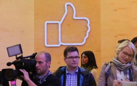 Journalists walk inside the new Facebook Innovation Hub during a media tour in Berlin