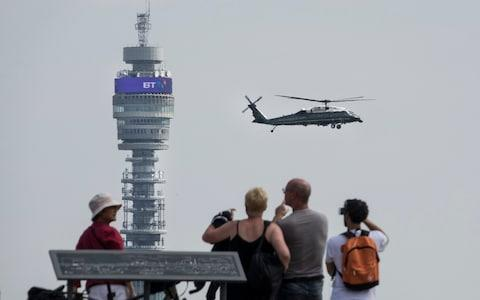 People watch from the top of Primrose Hill as President Trump comes into land on Marine One  - Credit: Peter Macdiarmid/LNP