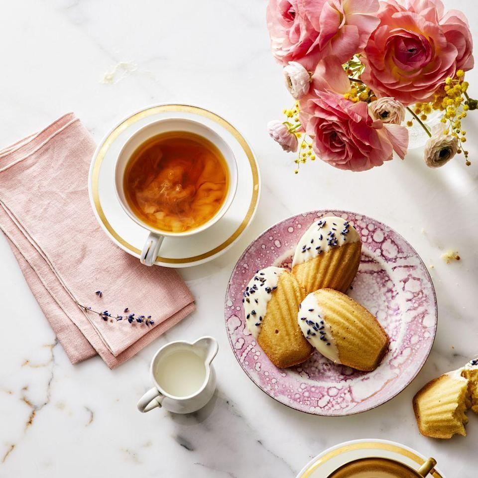 """<p>End an amazing spring meal with these dainty french cookies and a hot cup of tea.</p><p><em><a href=""""https://www.goodhousekeeping.com/food-recipes/dessert/a27274891/white-chocolate-and-lavender-madeleines-recipe/"""" rel=""""nofollow noopener"""" target=""""_blank"""" data-ylk=""""slk:Get the recipe for White Chocolate and Lavender Madeleines »"""" class=""""link rapid-noclick-resp"""">Get the recipe for White Chocolate and Lavender Madeleines »</a></em></p>"""