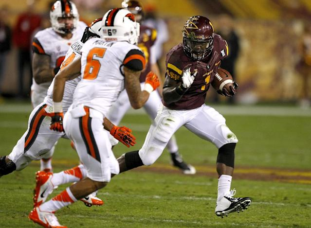 Arizona State running back Marion Grice (1) runs against Oregon State during the first half of an NCAA college football game on Saturday, Nov. 16, 2013, in Tempe, Ariz. (AP Photo/Rick Scuteri)