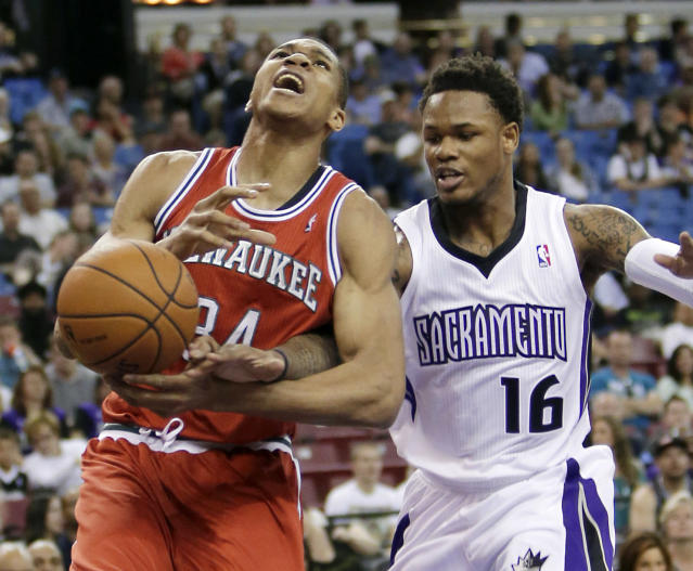Milwaukee Bucks guard Giannis Antetokounmpo, left, of Greece, is fouled by Sacramento Kings guard Ben McLemore during the first quarter of an NBA basketball game in Sacramento, Calif., Sunday, March 23, 2014.(AP Photo/Rich Pedroncelli)