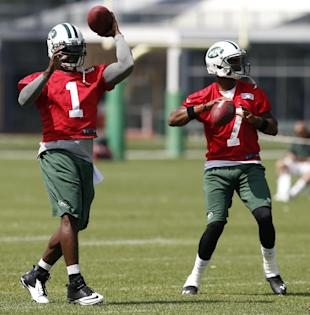 Michael Vick, left, and Geno Smith (AP)