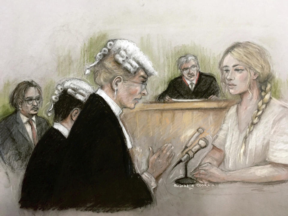 "In this court artist sketch by Elizabeth Cook, actress Amber Heard being questioned by Sasha Wass QC as she gives evidence at the High Court in London, Monday July 20, 2020. Amber Heard has begun giving testimony at Britain's High Court against ex-husband Johnny Depp, who she has accused of abusing her both physically and verbally during their tempestuous relationship. Depp, 57, is suing News Group Newspapers, publisher of the Sun, and the paper's executive editor, Dan Wootton, at the court in London over an April 2018 article that called him a ""wife-beater."" The Hollywood star strongly denies abusing Heard. (Elizabeth Cook via PA via AP)"