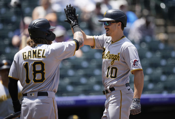 Pittsburgh Pirates' Ben Gamel, left, congratulates Bryan Reynolds as he crosses home plate after hitting a solo home run off Colorado Rockies starting pitcher Jon Gray in the first inning of a baseball game Wednesday, June 30, 2021, in Denver. (AP Photo/David Zalubowski)