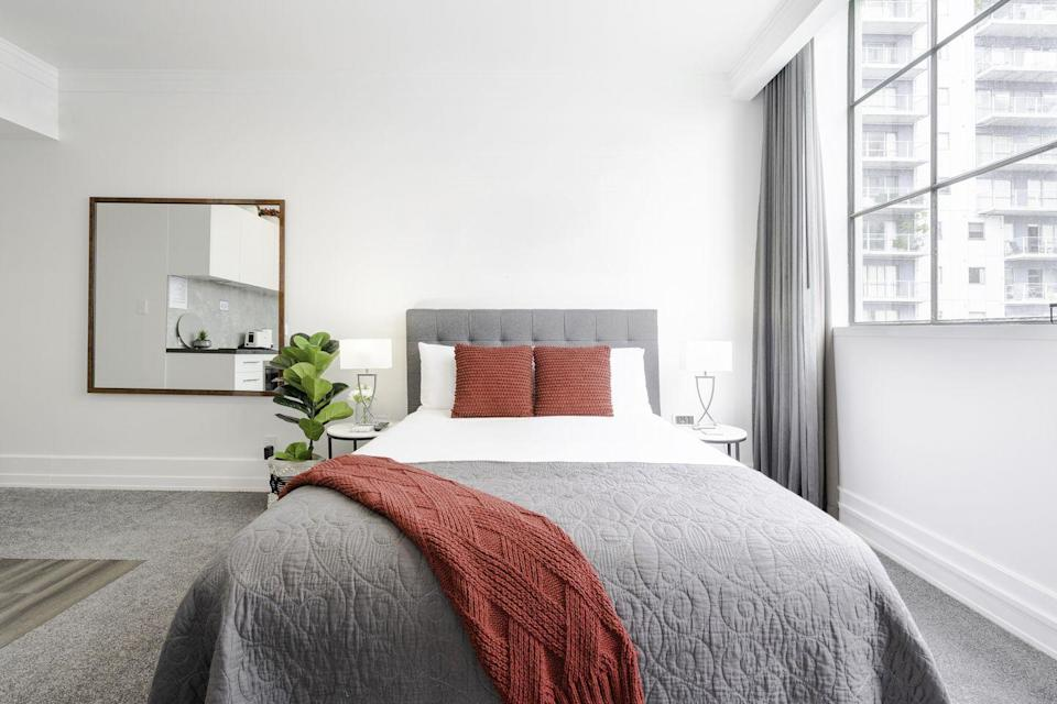 "<p>In addition to cleaning your linens, make sure you're <a href=""https://www.thespruce.com/clean-your-mattress-the-natural-way-350742"" rel=""nofollow noopener"" target=""_blank"" data-ylk=""slk:giving your mattress a good cleaning"" class=""link rapid-noclick-resp"">giving your mattress a good cleaning</a> a few times a year. Once you strip off your bedding, The Spruce recommends vacuuming the top, sides, and underside of your mattress. Then, mix one cup of baking soda with a few drops of lavender essential oil in a bowl and shake the fragranced baking soda evenly over the entire mattress through a strainer. Leave on for a few hours before vacuuming the baking soda off the mattress.</p><p>You can also remove any stains on the mattress by mixing a paste of baking soda, salt, and water. Rub the stain with the paste, let it sit for 30 minutes, and then wipe away with a damp clean cloth.</p>"