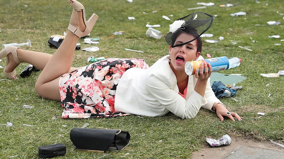 A racegoer, pictured here enjoying a lie down at the 2016 Melbourne Cup.
