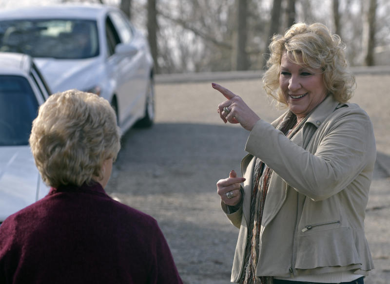 Rebecca Johnson, right, the Republican candidate for the Kentucky House of Representatives and wife of the former representative representing the 49th District speaks with a registered Republican voter Tuesday, Feb. 13, 2018, in Mt. Washington, Ky. The former representative, Dan Johnson, committed suicide in 2017, and she seeks to replace him in a special election being held Tuesday. (AP Photo/Timothy D. Easley)
