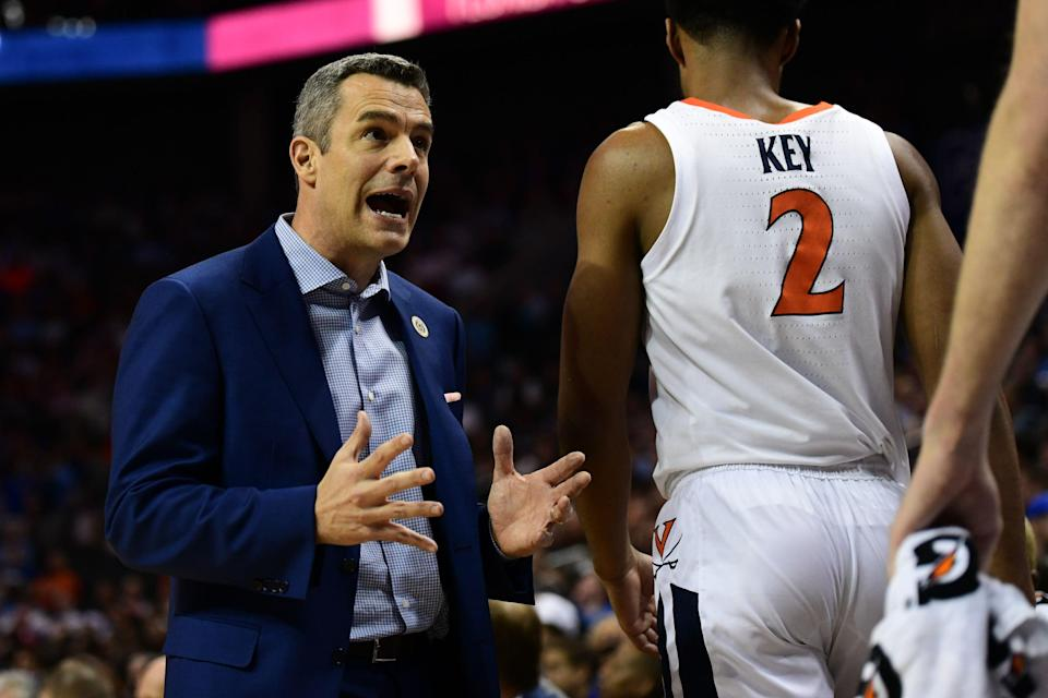 CHARLOTTE, NC - MARCH 15: Virginia Cavaliers head coach Tony Bennett talks to one of his players during the ACC basketball tournament between the Florida State Seminoles and the Virginia Cavaliers on March 15, 2019, at the Spectrum Center in Charlotte, NC. (Photo by William Howard/Icon Sportswire via Getty Images)