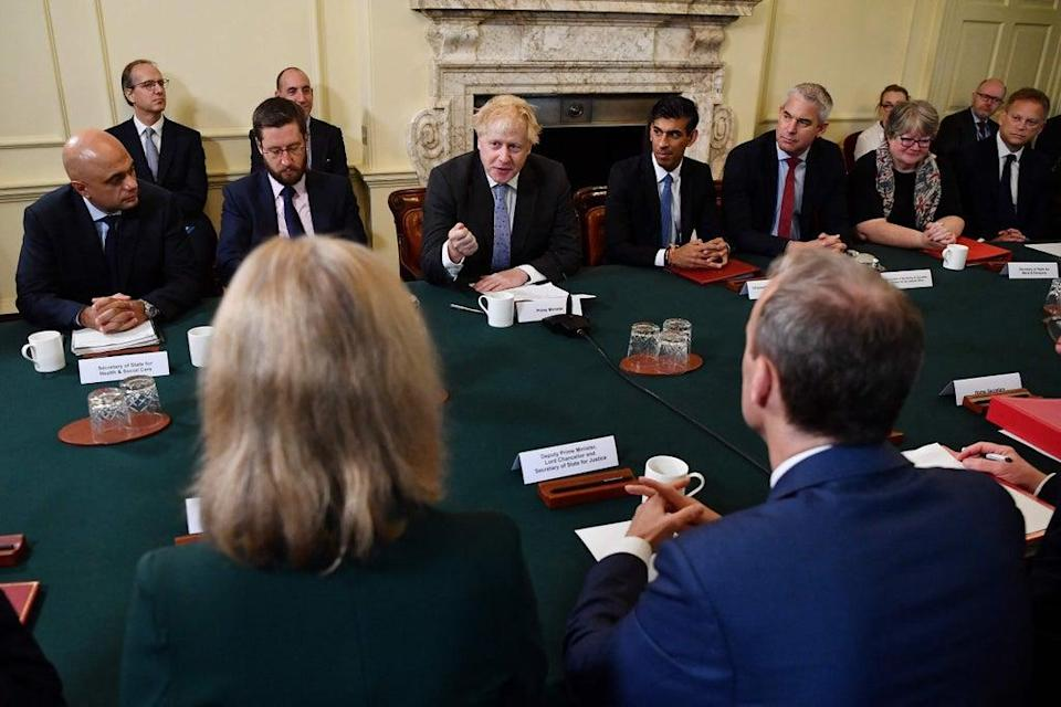 Mr Johnson was flanked by Cabinet Secretary Simon Case to his right and Chancellor Rishi Sunak (POOL/AFP via Getty Images)