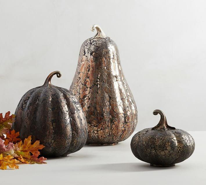 <p>You'll fall in love with the way these <span>Handcrafted Antiqued Glass Mosaic Pumpkins</span> ($40-$69) shine in the light.</p>