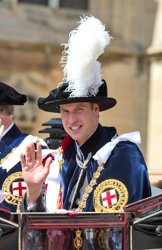 WINDSOR, ENGLAND - JUNE 18: Prince William, Duke of Cambridge waves to the crowd as he attends the Order of the Garter procession and service at Windsor Castle on June 18, 2011 in Windsor, England. The Order of the Garter is the senior and oldest British Order of Chivalry, founded by Edward III in 1348. Membership in the order is limited to the sovereign, the Prince of Wales, and no more than twenty-four members. (Photo by Paul Edwards - WPA Pool/Getty Images)