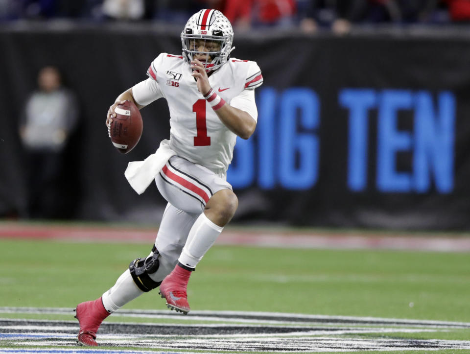 FILE - In this Dec. 7, 2019, file photo, Ohio State quarterback Justin Fields (1) runs with the ball against Wisconsin during the first half of the Big Ten championship NCAA college football game, in Indianapolis. Big Ten is going to give fall football a shot after all. Less than five weeks after pushing football and other fall sports to spring in the name of player safety during the pandemic, the conference changed course Wednesday, Sept. 16, 2020, and said it plans to begin its season the weekend of Oct. 23-24. (AP Photo/Michael Conroy, File)