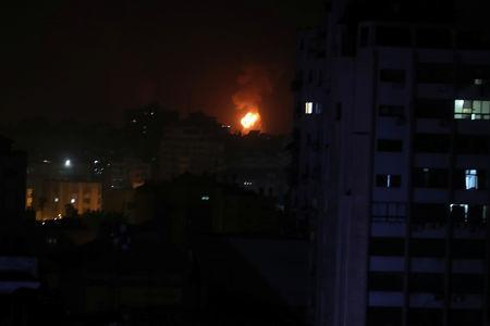 Smoke and flame are seen during an Israeli air strike in Gaza March 15, 2019. REUTERS/Mohammed Salem