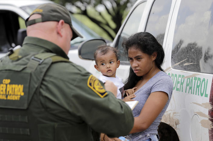 A woman migrating from Honduras holds her 1-year-old child as she surrenders to U.S. Border Patrol agents after illegally crossing the border on Monday near McAllen, Texas. (Photo: David J. Phillip/AP)