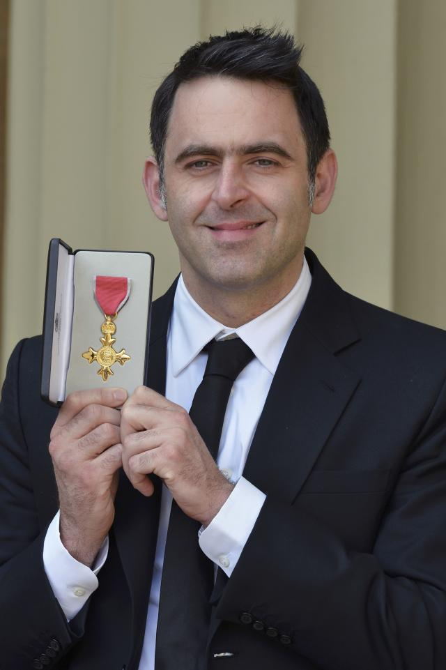 Snooker player Ronnie O'Sullivan poses after receiving an OBE from the Prince of Wales at an investiture ceremony at Buckingham Palace in London, Britain May 6, 2016. REUTERS/John Stillwell/Pool