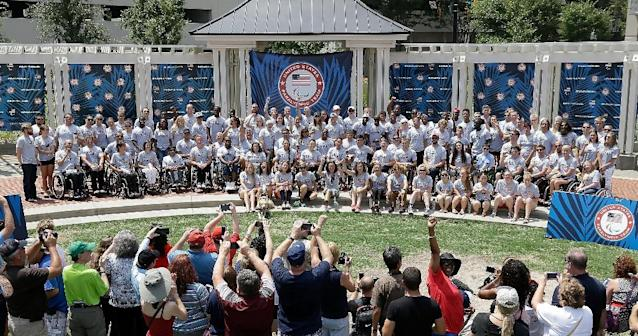 Members of the U.S. paralympics cycling, swimming and track and field teams pose for a team photo on July 3, 2016 in Charlotte, North Carolina (AFP Photo/Bob Leverone)