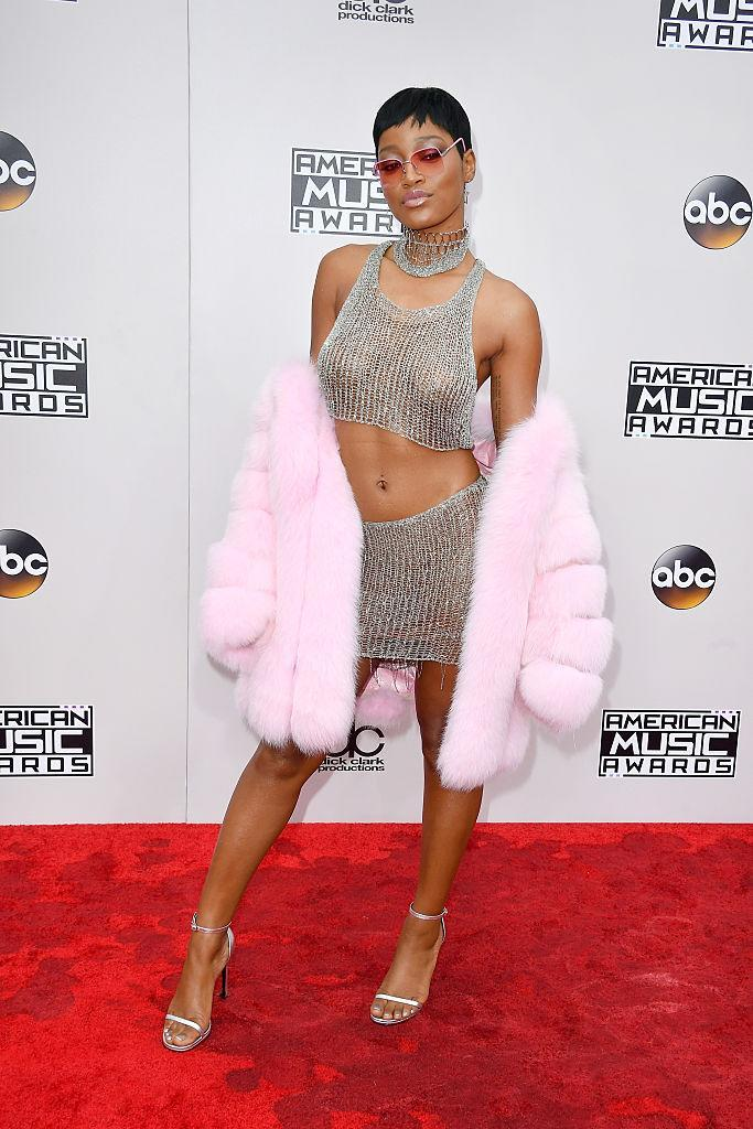 <p>Keke Palmer was giving off major Lil' Kim vibes in a chainmail top and matching skirt. She covered up with a pink fur coat and accessorized with matching shades. <em>(Photo: Getty Images)</em> </p>