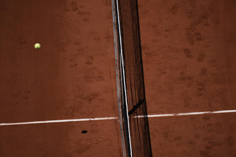 The ball passes over the net as United States's Coco Gauff plays Czech Republic's Barbora Krejcikova during their quarterfinal match of the French Open tennis tournament at the Roland Garros stadium Wednesday, June 9, 2021 in Paris. (AP Photo/Thibault Camus)
