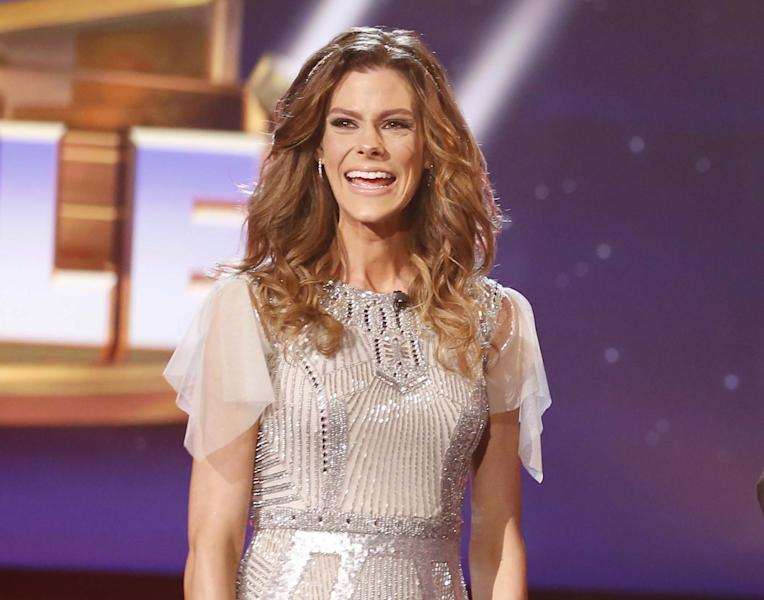 """This Feb. 4, 2014 photo released by NBC shows Rachel Frederickson on the finale of """"The Biggest Loser,"""" in Los Angeles. Fredrickson lost nearly 60 percent of her body weight to win the latest season of """"The Biggest Loser"""" and pocket $250,000. A day after her grand unveiling on NBC, she faced a firestorm of criticism in social media from people who said she went too far. (AP Photo/NBC, Trae Patton)"""