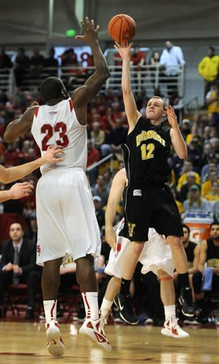 Vermont's Sandro Carissimo (12) shoots over Stony Brook's Dallis Joyner (23) during the second half of the America East Conference tournament championship NCAA college basketball game on Saturday, March 10, 2012, in Stony Brook, NY. Vermont won 51-43. (AP Photo/Kathy Kmonicek)
