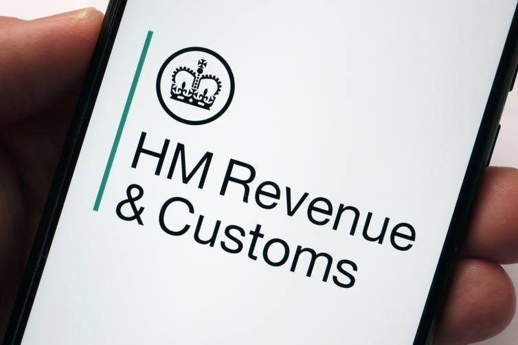 A phone showing the HMRC logo