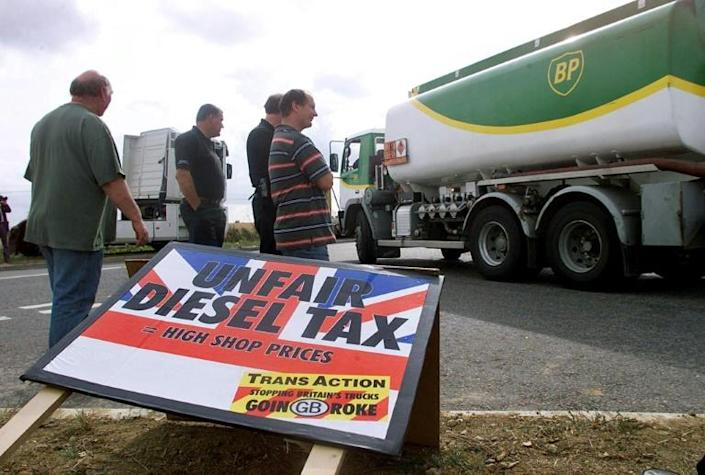 In late 2000, anger over high fuel prices and the government's refusal to waive or reduce duty triggered a blockade of oil refineries, bringing the country to a virtual halt (AFP/ADRIAN DENNIS)