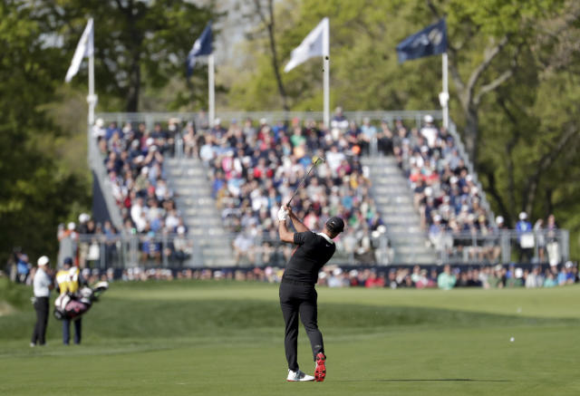 Brooks Koepka hits onto the 12th green during the first round of the PGA Championship golf tournament, Thursday, May 16, 2019, at Bethpage Black in Farmingdale, N.Y. (AP Photo/Julio Cortez)