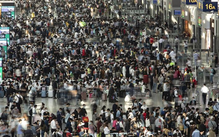 Passengers wait in Hongqiao High-speed Railway Station in Shanghai - Qilai Shen/Bloomberg