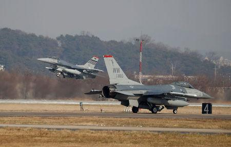 U.S. Air Force F-16 fighter jets take part in a joint aerial drill exercise called 'Vigilant Ace' between U.S. and South Korea, at the Osan Air Base in Pyeongtaek