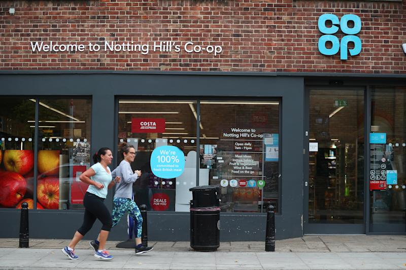Women jog past a Co-op supermarket in London, Britain, September 14, 2018. REUTERS/Hannah McKay