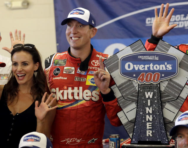 "<a class=""link rapid-noclick-resp"" href=""/nascar/sprint/drivers/947/"" data-ylk=""slk:Kyle Busch"">Kyle Busch</a>, right, and his wife Samantha Busch celebrate with the trophy in Victory Lane after his win in a NASCAR Cup Series auto race at Chicagoland Speedway in Joliet, Ill., Sunday, July 1, 2018. (AP Photo/Nam Y. Huh)"