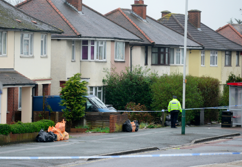 <em>A house is cordoned off and searched by police close to where the man was shot dead (SWNS)</em>