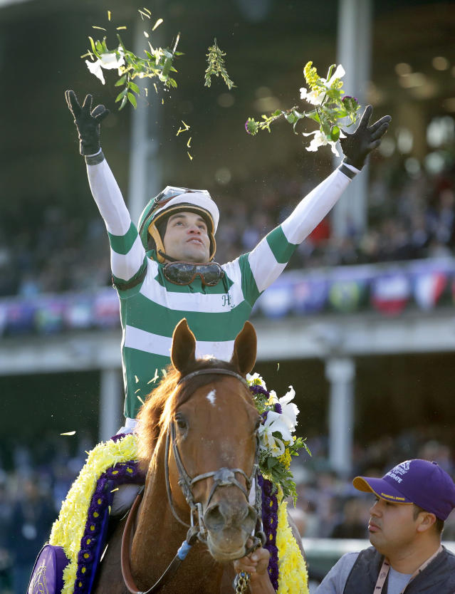 Joel Rosario celebrates after riding Accelerate to victory in the Breeders' Cup Classic horse race at Churchill Downs, Saturday, Nov. 3, 2018, in Louisville, Ky. (AP Photo/Darron Cummings)
