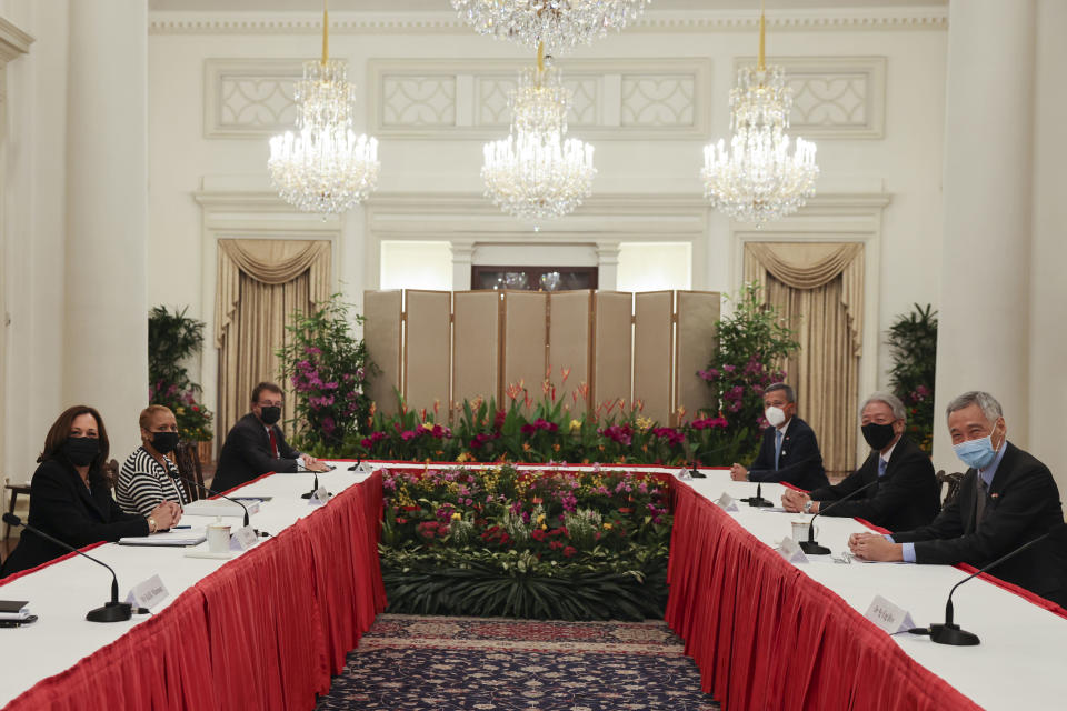 U.S. Vice President Kamala Harris, left, meets Singapore's Prime Minister Lee Hsien Loong, right, in a bilateral meeting at the Istana in Singapore Monday, Aug. 23, 2021. (Evelyn Hockstein/Pool Photo via AP)