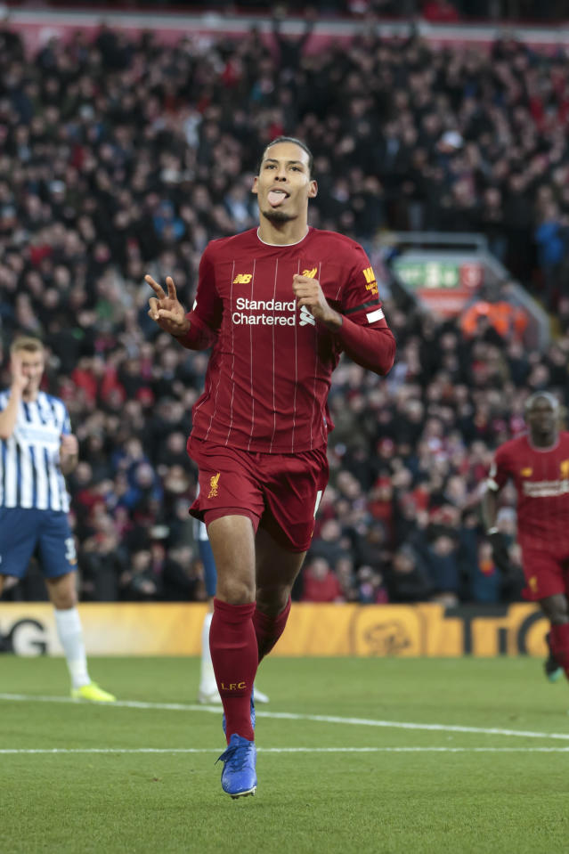 Liverpool's Virgil van Dijk celebrates after scoring his second goal during the English Premier League soccer match between Liverpool and Brighton at Anfield Stadium, Liverpool, England, Saturday, Nov. 30, 2019. (AP Photo/Jon Super)