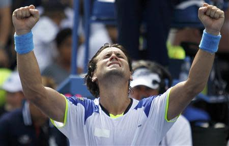 David Ferrer of Spain celebrates after defeating Mikhail Kukushkin of Kazakhstan at the U.S. Open tennis championships in New York August 31, 2013. REUTERS/Eduardo Munoz