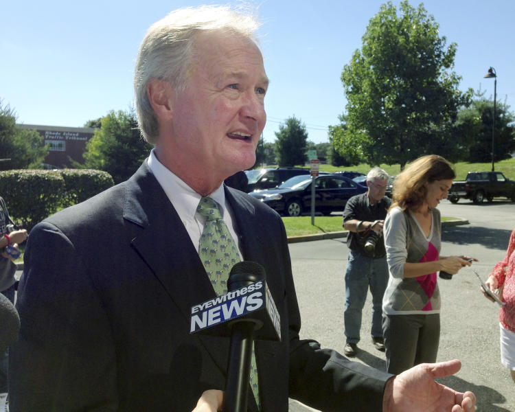 Rhode Island Gov. Lincoln Chafee speaks to media outside a department of motor vehicles office Wednesday, Sept. 4, 2013, in Cranston, R.I. Chafee said he is not running for a second term, bowing out of what was expected to be a fierce primary in his new Democratic Party. (AP Photo/Michelle R. Smith)