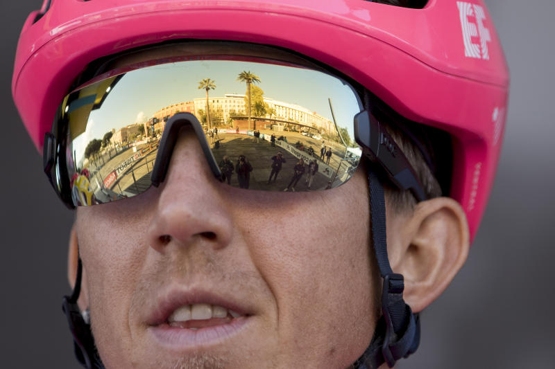 An empty presentation venue is reflected in the glasses of EF Pro Cycling's Sep Van Marcke, of Belgium, before the start of the seventh stage of the Paris Nice cycling race in Nice, southern France. The eighth and final stage of the event was cancelled and spectators are prevented from attending the race due to measures in place to prevent the spread of the Covid-19 virus. For most people, the new coronavirus causes only mild or moderate symptoms. For some it can cause more severe illness. Stage seven runs just over 166 kilometers starting in Nice and finishing in Valdeblore La Colmiane, France, Saturday, March 14, 2020. (AP Photo/Daniel Cole)