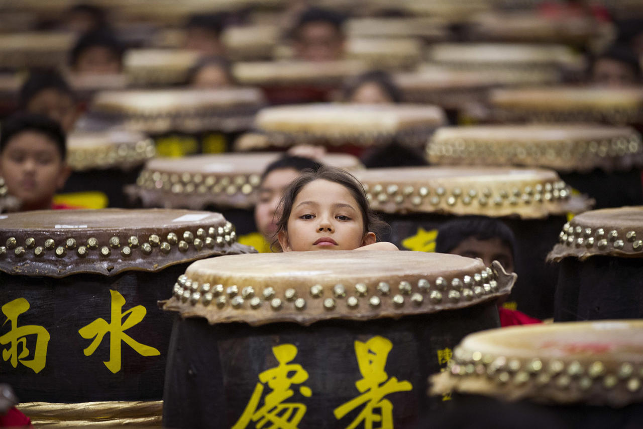 "<p>Young drummers stick out their heads among drums while preparing for the performance of ""A Flourish of Hundreds Drums"" in Kuala Lumpur, Malaysia, Jan. 8, 2017. (Photo: Lim Huey Teng/AP) </p>"
